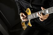 pic of guitarists  - Close up of a boy playing a electric guitar.