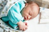 New born baby sleeping with hands folded