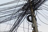 Tangle of Electrical Wires on Power Pole