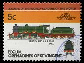 BEQUIA - CIRCA 1985: A stamp printed in Grenadines of St. Vincent shows Jersey Lily Train 4-4-2, 1903 U.K., circa 1985