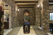 Stone entrance hallway at a spacious house