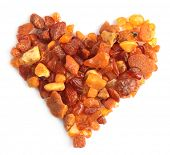 Heart-shaped pieces of amber against white background