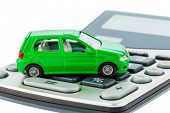 a car is on a calculator. cost of gasoline, wear and insurance. car costs are not paid by commuter tax.