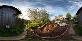 Spherical, 360 degrees panorama (equiregtangular projection) of a spring blooming garden in a villag