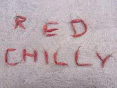 Red Chilly written using spicy red chillies