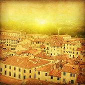 Grunge image of Lucca at sunset, old town in Tuscany. Italy.