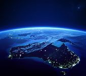 Australia with city lights from space at night - Earth daytime series (Elements of this 3d image furnished by NASA)