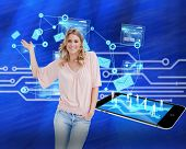 Blonde woman presenting something against white circuit board on blue background