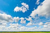 Beautiful Clouds And Blue Sky Over Field And Fores