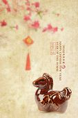 Ceramic horse souvenir on old paper,Chinese calligraphy. word for