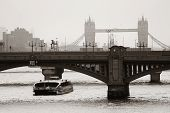 London silhouette with bridges over Thames River.