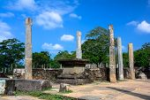 picture of polonnaruwa  - The structure is an elevated stone platform with a number of stone columns and surrounded by a low stone wall - JPG