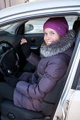 Pretty Young Woman In Winter Clothes Sitting In A Car