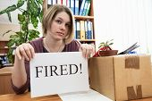 Dismissed Worker With Sheet Of Paper With Fired Word In The Office
