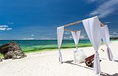 stock photo of wedding arch  - Wedding arch decorated on tropical beach with white sand - JPG