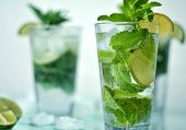 stock photo of lime  - Fresh mojito cocktail with lime and ice - JPG