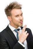 Portrait of businessman hand gun gesturing, isolated on white