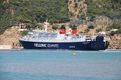 SKOPELOS, GREECE - JUNE 24, 2013: Hellenic Seaways ferry Express Pegasus departs Skopelos Town harbour on the Greek island of Skopelos. The ship was built in Italy in 1977.