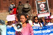 KATHMANDU, NEPAL - NOV 29: Unidentified participants protest within a campaign to end violence again