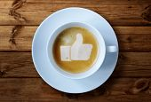 picture of wooden table  - Thumbs up or like symbol in coffee froth - JPG
