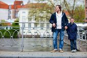 Father and son in European city on spring day