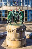 Sculpture of three dancing fauns