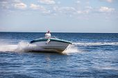 Man driving a fast boat