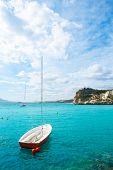 Altea Mediterranean sea detail with sailboat in alicante Spain