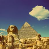 famous ancient egypt Cheops pyramid and sphinx in Giza - vintage retro style