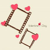 Happy Valentines Day celebration concept with blank photo frame set on brown background, love concep