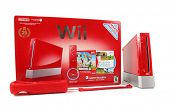 BOISE, ID - JANUARY 31, 2014: The Wii gaming system in special edition red color with a remote and manufacturer's box.