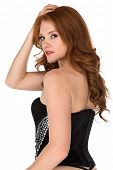 foto of bustiers  - Petite freckled redhead in a black corset - JPG