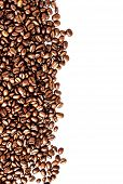 Brown Roasted Coffee Beans Isolated On White Background.  Arabic Roasting Coffee - Ingredient Of Hot