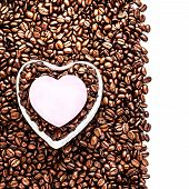 oasted Coffee Beans with Heart Shaped Paper Sheet over coffee bean