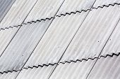 stock photo of asbestos  - Corrugated grey asbestos cement roof sheet  - JPG
