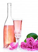 Composition with pink sparkle wine in glass, bottle and pink roses isolated on white