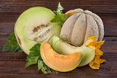 stock photo of muskmelon  - Fresh domestic cantaloupe melon on a wooden background - JPG