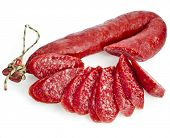 Hungarian smoked sausage with paprika isolated on white background