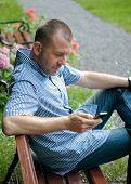 Man Looking At Smartphone