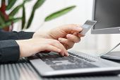 Man Is Using Credit Card And Computer For  On Line Payment. Internet Shopping Concept