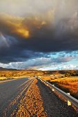 picture of pampa  - Low swirling cloud and flat plain covered in orange sunset - JPG