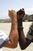 Handshake Between A Caucasian And An African