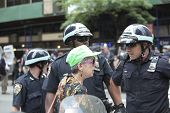 Legal observer (green hat) confers with NYPD