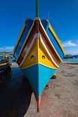 Постер, плакат: Traditional Maltese Colorful Boat In Marsaxlokk Village