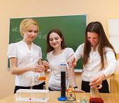 Girls Working In Chemistry At The Classroom