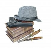picture of murders  - Murder mystery books with gun knives and fedora hat  - JPG