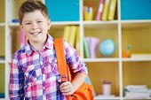 image of pre-adolescents  - Portrait of smiling schoolboy with backpack looking at camera - JPG