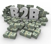 B2B 3d Letters surrounded by stacks or piles of hundred dollar bills as earnings, revenues or profit