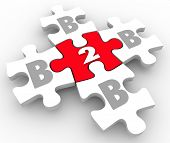 B2B letters on puzzle pieces connecting as businesses network and sell products and services to each