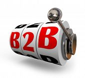 B2B letters on slot machine dials or wheels as gambling or betting on business sales from one company to another